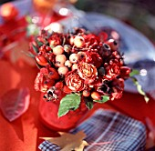 ARRANGEMENT OF ROSEHIPS, SMALL ROSES AND APPLES
