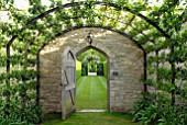 PEAR TUNNEL AND DOORWAY AT OZLEWORTH PARK, GLOUCESTERSHIRE