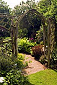 RUSTIC WOODEN ARCH AND TRELLIS WORK AT WHIT LENGE GARDEN,  HARTLEBURY