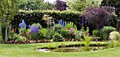 A COTTAGE GARDEN STYLE BORDER WITH POND